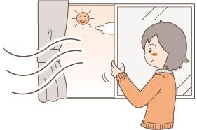 窓をあける女性